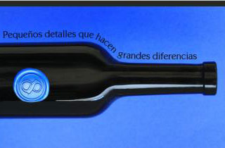 Black bottle with sealing wax medallion in royal blue color