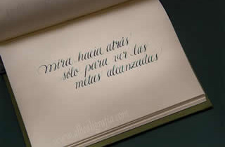Calligraphic text in a notebook, look back just to see the achievements