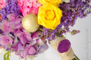 Bouquet of flowers tied and sealed with a purple sealing wax medallion