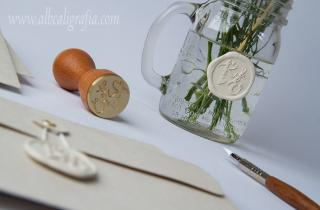Sealed jar with flowers in ivory, sealing wax seal and calligraphic pen