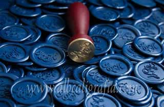 Sealing wax medallions in navy blue color and sealing wax seal