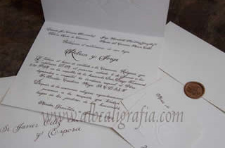 Wedding invitation in calligraphic style with cupper sealing wax