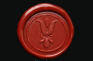 Red earth sealing wax medallion with greek flower seal