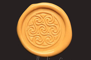 Yellow sealing wax medallion with celtic spirals seal
