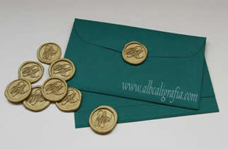 Green envelope with gold sealing wax medallions