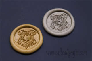 Gold and silver sealing wax medallions with sield