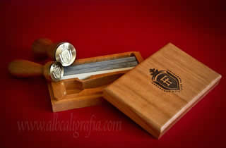 Sealing wax set that includes seals, silver and ivory sealing wax  and wooden box engraved with a shield