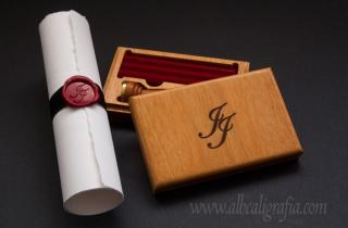 Wooden box with red sealing wax bars, engraved with initials JJ and parchment with black ribbon and red wax medallion