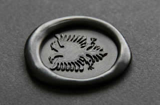 Black sealing wax medallion with bicefal eagle stampt