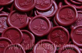 Sealing wax medallions in red color for wine bottles