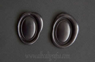 Black sealing wax medallions oval and convex