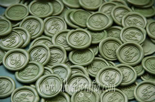 Green sealing wax medallions with initials ES