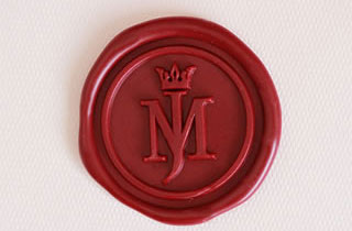 Red sealing wax sticker rwith initials MJ and crown