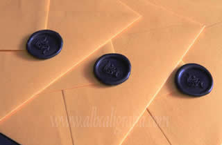 Envelopes ocher with black wax stickers