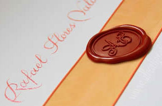 Invitation with red seling wax, decoration ribbon and calligraphy in orange color