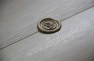 Wedding invitation in silver paper with silver sealing wax