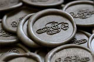 Sealing wax medallions in silver color for wedding invitations