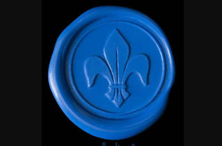Fleur de liz in royal blue sealing wax medallion