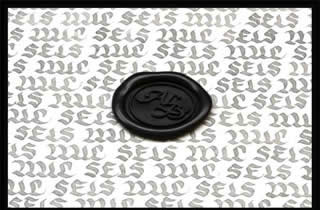 Calligraphic text in which the words six thousand  are repeated and on top o it is a  sealing wax black medallion with the initials ALB