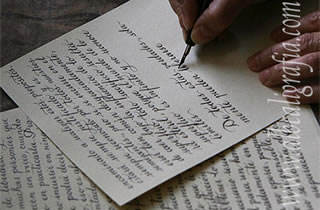 Letter writtenin calligraphy and hands of the calligrapher